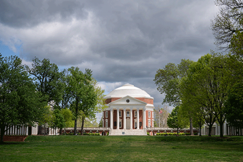 The Rotunda surrounded by leaving trees with the Lawn in foreground